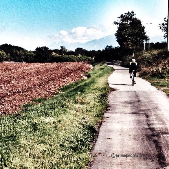 Cycling towards the lake of Garda